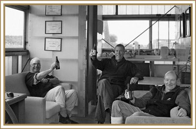 Mike, Roger, and Clive enjoying a beer.